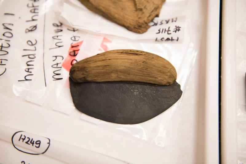 A traditional Yup'ik cutting utensil called an uluaq, found at the Nunalleq dig site, sits in the lab in Quinhagak, Alaska.