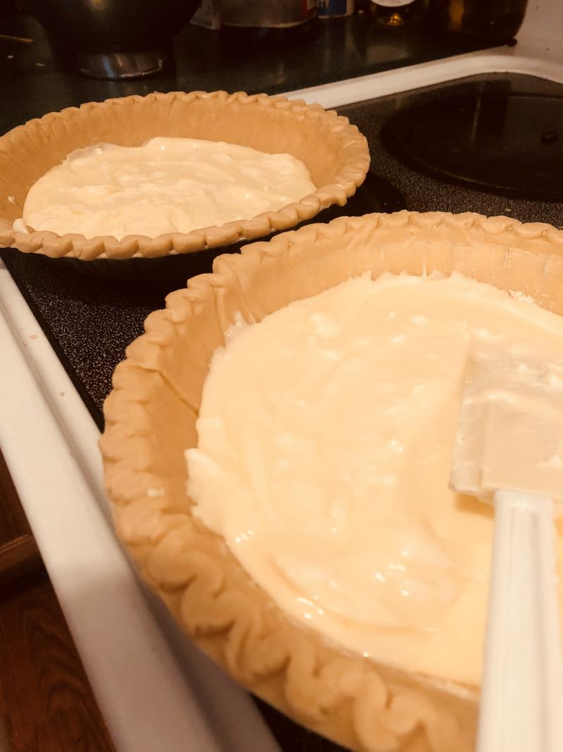 Pour cream cheese mixture into two pie crusts.