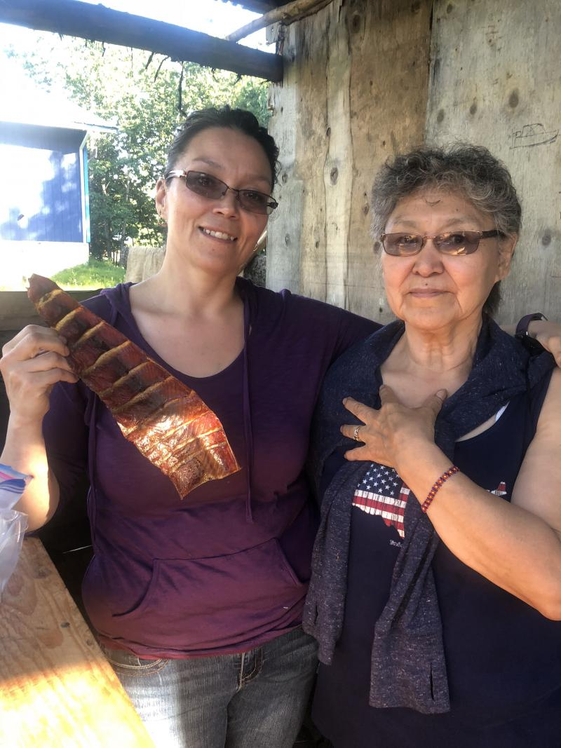 L-R: Dorris Allain holding a half dried flat fish. Dorris' mother, Anna Allain of Aniak on July 5, 2018.