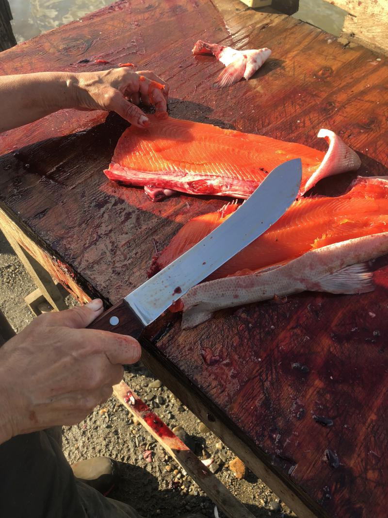 Francine Kvamme is used to cutting her fish with a 12-inch knife.