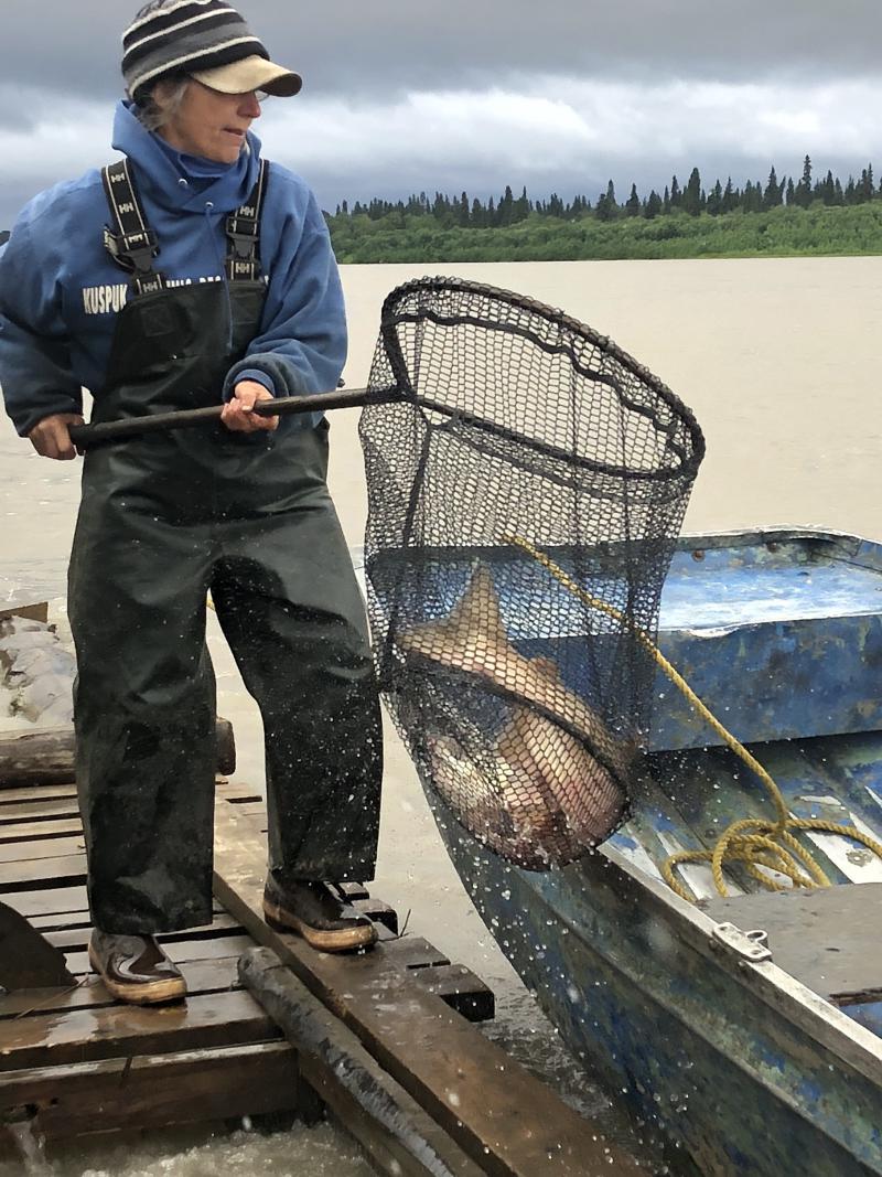Barb Carlson checks the chute at the Sleetmute fish wheel.