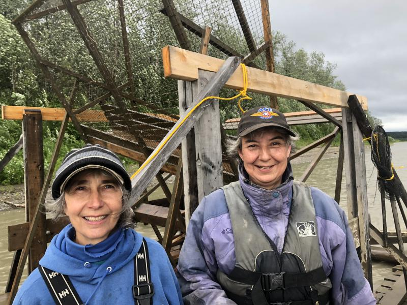 Barb Carlson (left) and Margaret Bobby (right) at the Sleetmute fish wheel.