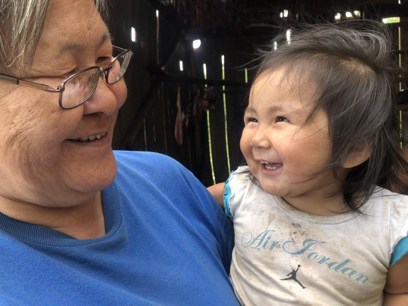 Christine John (left) and her 1-year old granddaughter, Esther Sakar (right).