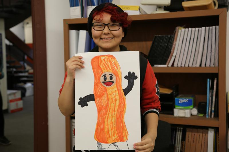 LKSD student Dorothy Jackson from Nightmute shows her Halloween costume design for a salmon strip that looks like bacon.
