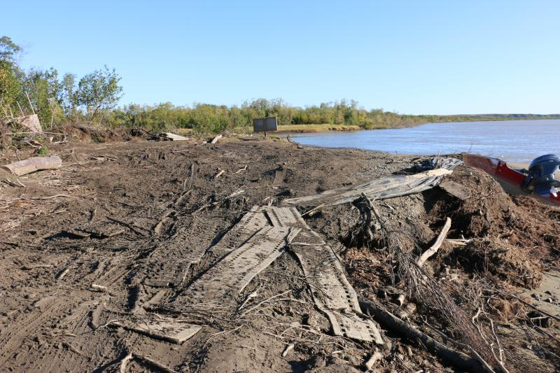 A Memorial Day storm in 2018 washed away 30 feet of Napakiak's riverbank overnight, destroying the community's boat and hovercraft landing. The community has laid snowmachine tracks salvaged from the landfill on the crumbling riverbank to gain traction.