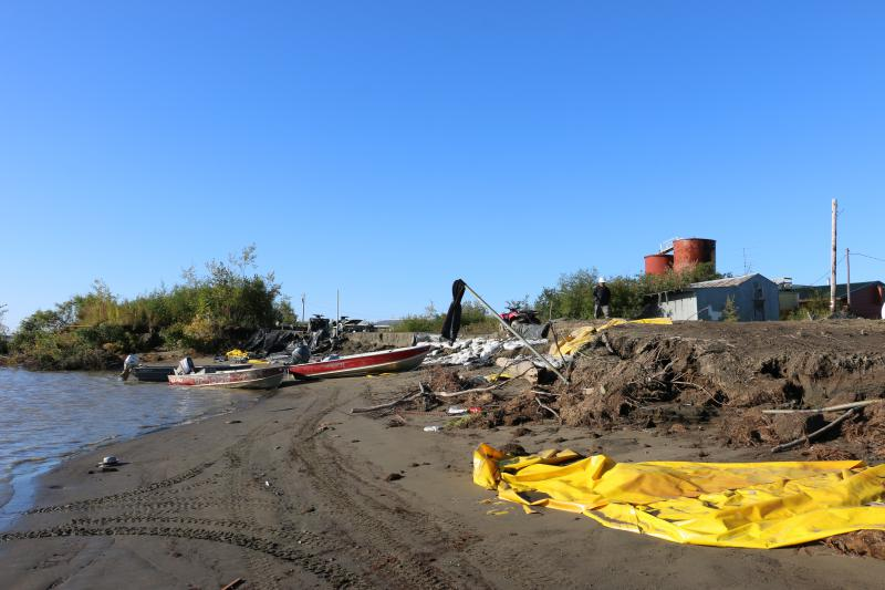 The City of Napakiak, the Native Village of Napakiak, and the Napakiak Village Corporation have joined resources to lay tarps and sandbags on the Napakiak riverbank as a stopgap measure to protect the shore from erosion. September 7, 2018.