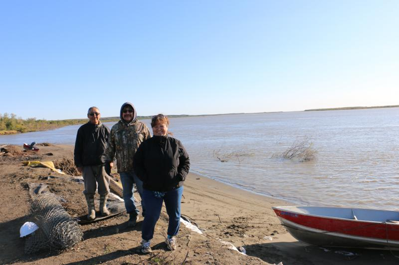 (Left to right) Napakiak City Council Member Walter Nelson, Village Corporation Board Member David Black, and Mayor Joann Slats. With other community members, they are advocating for funding to relocate Napakiak and seeking erosion mitigation measures.