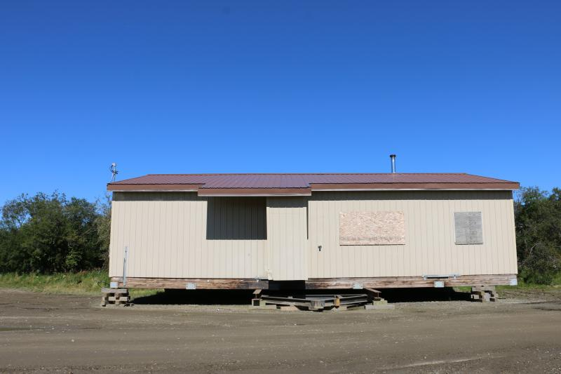 Napakiak relocated its community multipurpose building after a Memorial Day storm in 2018 nearly washed it away. The storm eroded 30 feet of riverbank overnight. Napakiak has been moving buildings further away from the encroaching riverbank for decades.