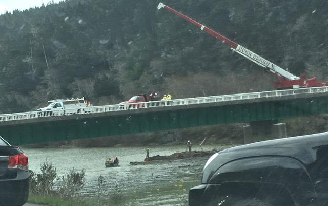 Caltrans crews work to remove a log jam at the Navarro River Bridge