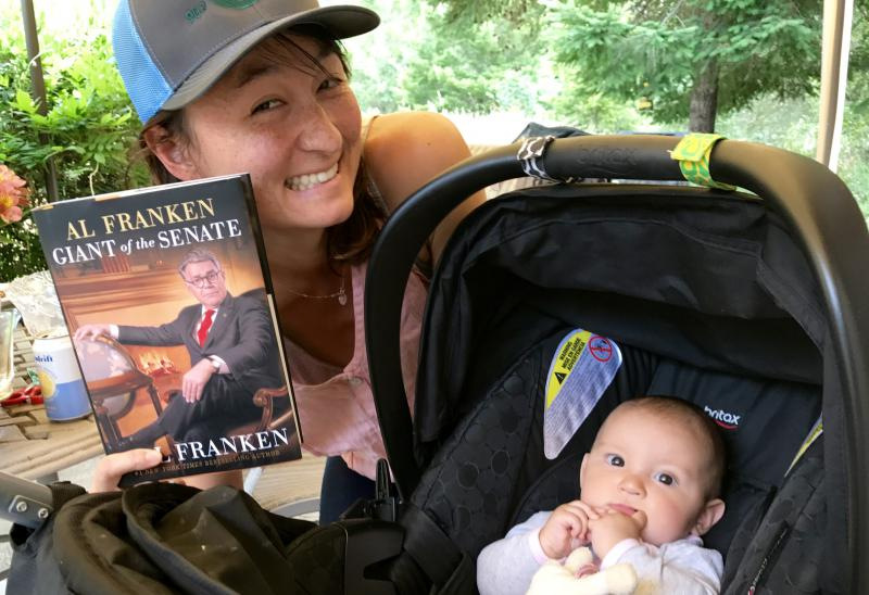 "Valerie Kim and Juno with Pledge Drive thank you gift, ""Al Franken: Giant of the Senate"""
