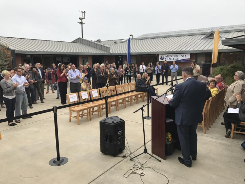 Mendocino Community College President Arturo Reyes addresses College supporters on August 9 at the ribbon cutting ceremony for its Coast Center in Fort Bragg. The campus was acquired from College of the Redwoods.