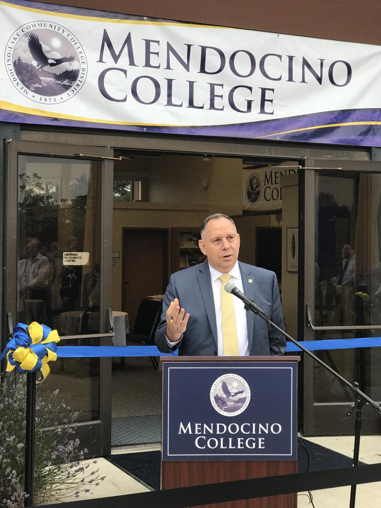 Mendocino Community College President Arturo Reyes speaks on August 9 at a ribbon-cutting ceremony for the College's Coast Center in Fort Bragg. The campus was acquired from College of the Redwoods.