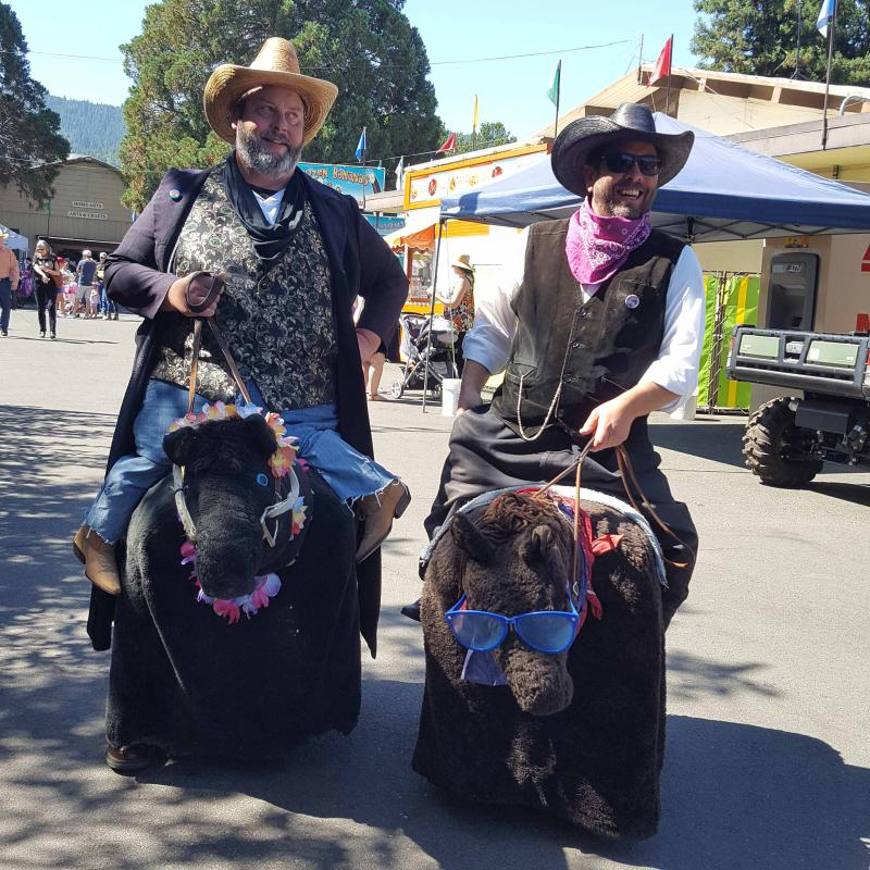 Slim and Curly, Fables of the West, welcome visitors to the fair.