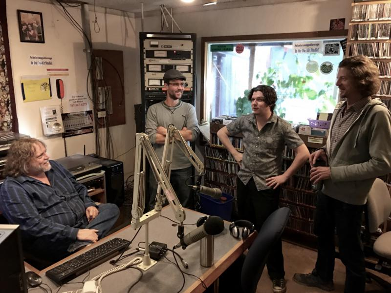 Operations Director Rich Culbertson (seated) discusses Federal Communication Commission regulations with (L-R) Recording Arts students Bob Demay and Steve Keith, and station volunteer Michael Fix.