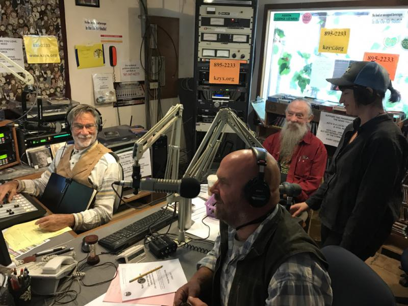 """As Program Director Alice Woelfle-Erskine looks on, veteran KZYX programmers Fred Wooley, """"W Dan"""" Houck, and Dan Roberts (L-R) appeal to listeners for  nancial support during a recent Pledge Drive."""