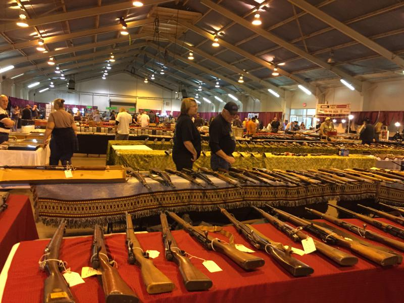 Tables of rifles and shotguns at the gun show