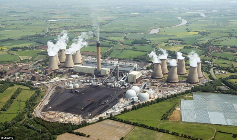 An aerial view of Drax Power Station near Selby in North Yorkshire, England. Drax is the single largest producer of CO2 emissions in Britain  Read more: http://www.dailymail.co.uk/news/article-4255010/Idiocy-replacing-coal-power-stations-burning-wood.html