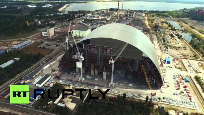 A containment structure being built over the wreckage of the Soviet-era Chernobyl nuclear power plant in Ukraine