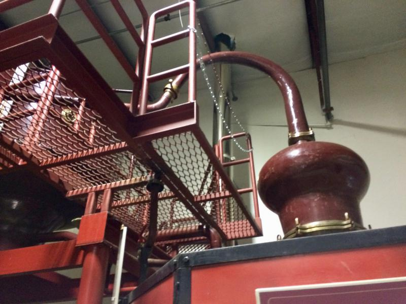 "A view of the ""swan's neck"" portion of the main alembic still at American Craft Whiskey Distillery"