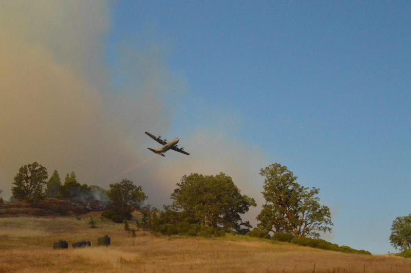 A US Forest Service aircraft drops fire retardant on Mendocino County's Eel Fire, burning in the Mendocino National Forest