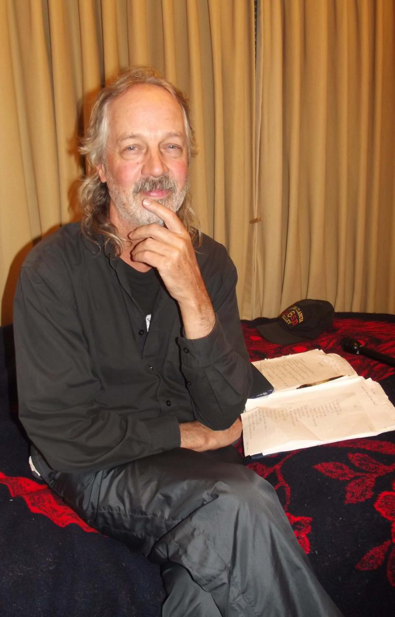 Rod O'Meara, sitting next to his poems