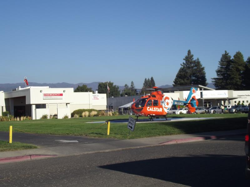 A chopper lands on the lawn in front of the hospital on Thursday evening.