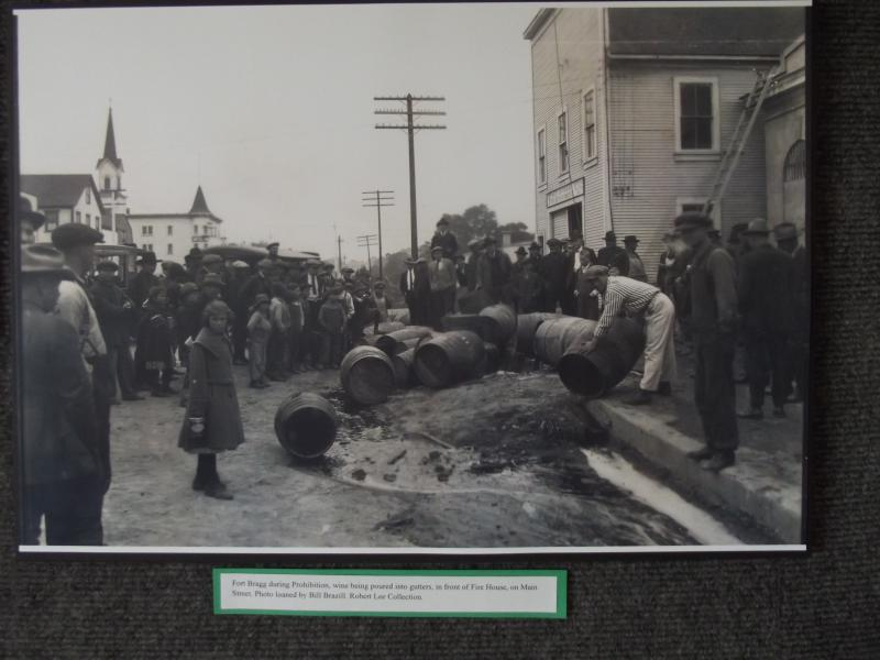 Wine being poured into the streets of Fort Bragg during alcohol Prohibition.