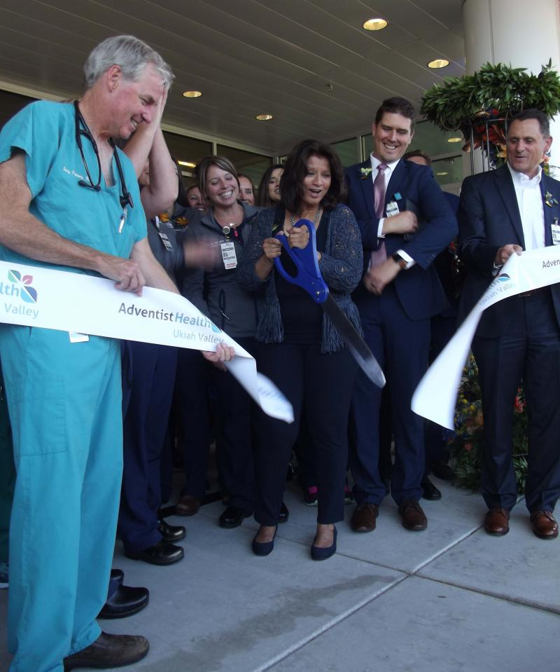 Ukiah Valley Medical Center CEO Gwen Matthews cuts the ribbon at a ceremony Thursday night.