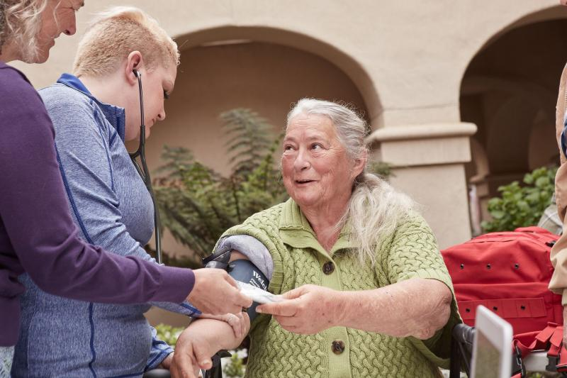 A patient is treated by staff of the Adventist Health Ukiah Valley street medicine team