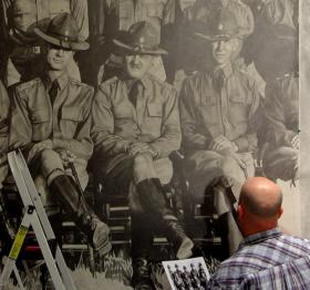 aPorte works on one panel of his pencil drawing that won ArtPrize