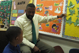 Robert Bobb helps student with homework
