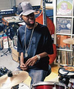 J Dilla at a drum set