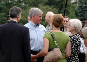 Rick Snyder talking to people