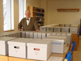 Eugene G. Wanger and boxes of documents from the Michigan Constitution