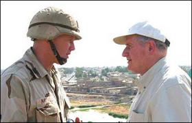 Senator Levin speaks with military member