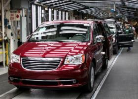 A 2011 Chrysler Town & Country rolls off the final inspection line at Chrysler Group LLC's Windsor Assembly Plant.