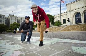 Hip Hop duo Passalacqua in front of the Detroit Institute of the Arts checking out part of the 4 mile long hopscotch course the was created during the Detroit Design Festival.