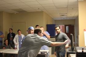 photo of Kettering students Tyler Garavaglia (left) and Reza Yousefian (right) discussing the surgical simulator.