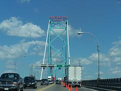 A truck and other traffic crossing the Ambassador Bridge.