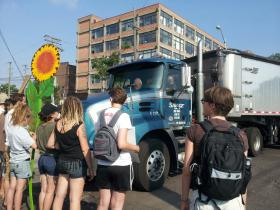 Protesters block a truck carrying pet coke from a loading dock on the Detroit River.
