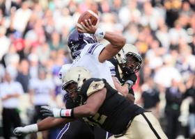 Northwestern's Kain Colter is tackled during a game with Army in 2011. Colter has argued the players should be allowed to form a union.
