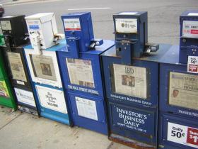 Newspaper boxes along a street