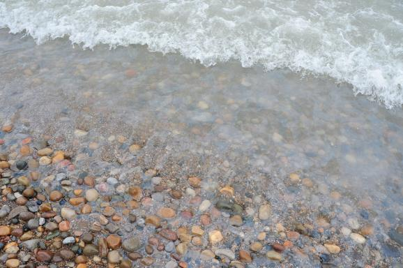 The sheen of diesel fuel on the shores of Lake Huron near Lakeport, Michigan.