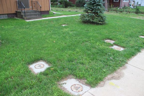 Monitoring and/or remediation wells in the front yard.