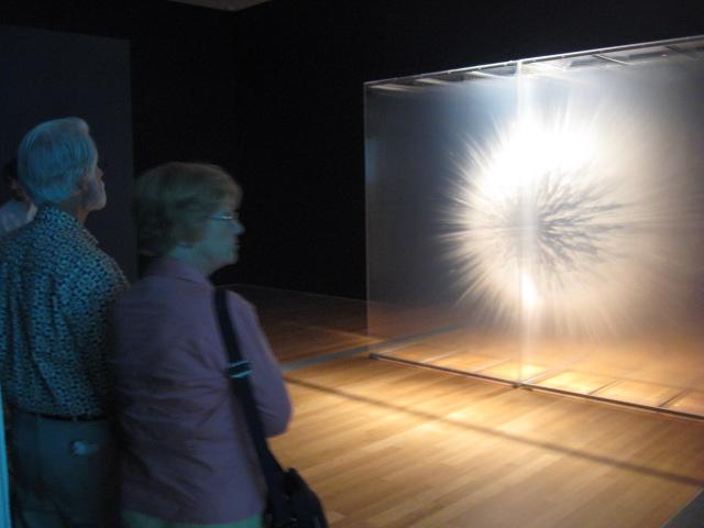 "ArtPrize visitors check out a piece titled ""Vision"" by David Spriggs, at the Grand Rapids Art Museum."