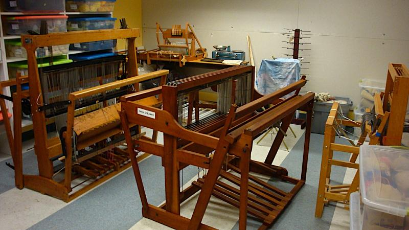 These looms were owned by the Cross Village Rug Works. When they closed, they sold their looms at steep discounts hoping to keep independent rug makers in business. The leftover looms were donated to North Central Michigan College.