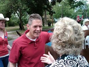 Congressional Mark Schauer (D) talks with a constituent