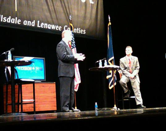 Incumbent Democratic congressman Mark Schauer (right) listens as Republican challenger Tim Walberg makes a point during their debate at JCC's Potter Center.