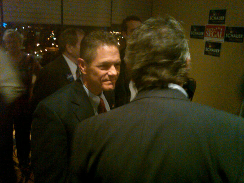 Mark Schauer talks with supporter at his victory party in Battle Creek.