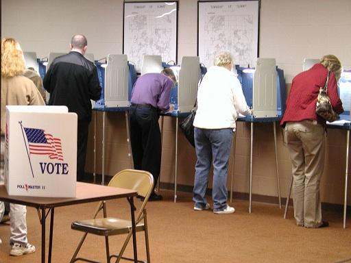 Voters filling out ballots.